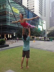 Practicing standing acroyoga in Singapore at a park jam